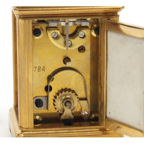 54 - Gilt brass miniature carriage clock with Sevres style porcelain panels decorated with flowers, numbe...