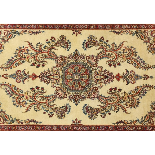 2015 - Rectangular Kashan rug, having an all over floral design, 225cm x 135cm...