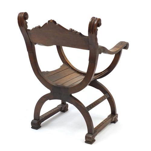 2007 - Italian oak savonarola chair carved with grotesque masks, 84cm high
