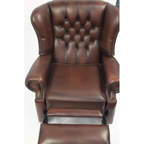 2048 - Brown leather wingback reclining armchair with button back, 99cm high...