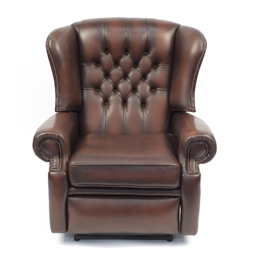 2049 - Brown leather wingback reclining armchair with button back, 99cm high...