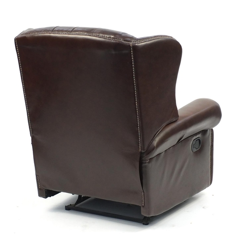 2049 - Brown leather wingback reclining armchair with button back, 99cm high