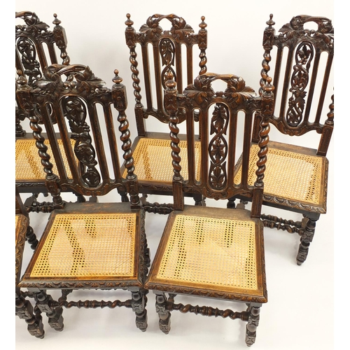 2036 - Harlequin set of seven carved oak barley twist chairs with cane seats, 107cm high...