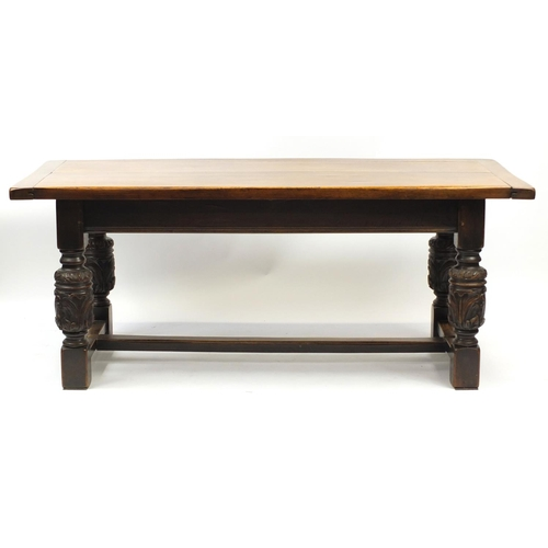2008 - Oak refectory table with carved cup and cover bulbous legs united by a H stretcher, 73cm H x 184cm W...