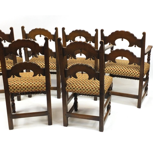 2009 - Set of six carved oak dining chairs including two carvers, with polka dot upholstered stuff over sea...