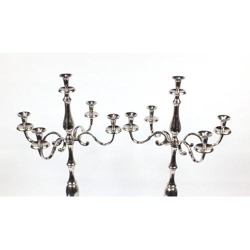 2013 - Pair of floor standing chromed five branch candelabras, each 49cm high...
