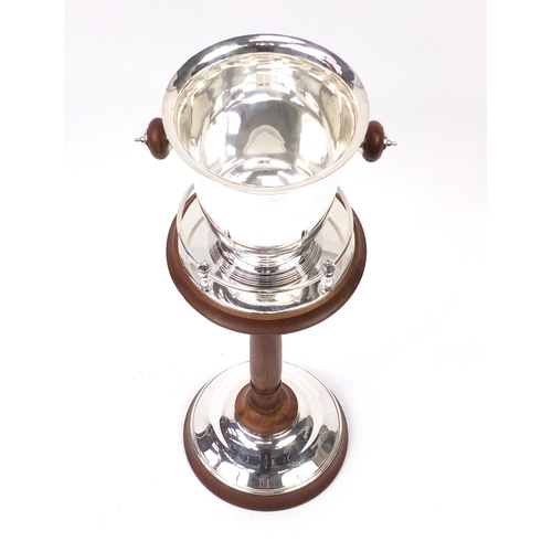 2056 - Contemporary silver plated champagne bucket on stand, 78cm high...