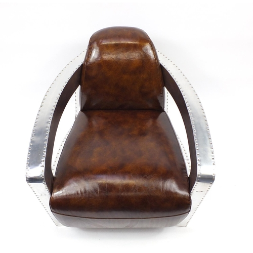 2024 - Aviation club chair with brown leather upholstery, 77cm high...