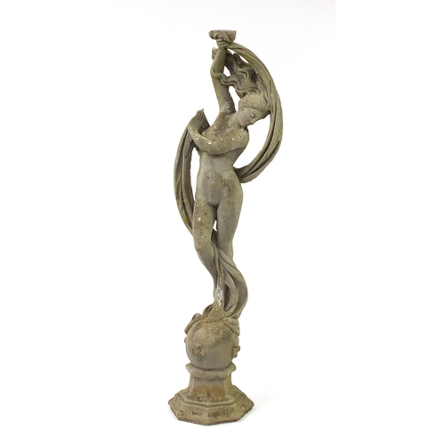 2021 - Reconstituted stoneware garden statue of a nude maiden standing on a ball, 170cm high...