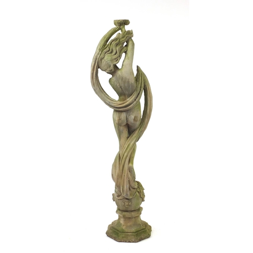2021 - Reconstituted stoneware garden statue of a nude maiden standing on a ball, 170cm high