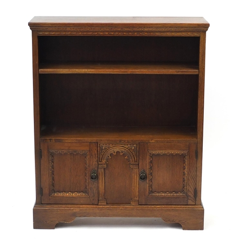 2014 - Ipswich oak open bookcase fitted with a pair of cupboard doors to the base, 102cm H x 84cm W x 25cm ...
