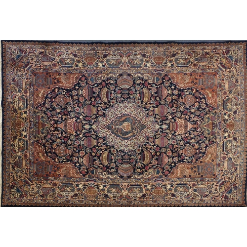 2004 - Very fine rectangular Persian Kerman Laver carpet, having an all over traditional design onto midnig...