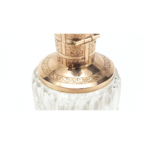 23 - Dutch cut glass scent bottle with 14K gold mounts engraved with flowers, impressed oak leaf to the m...