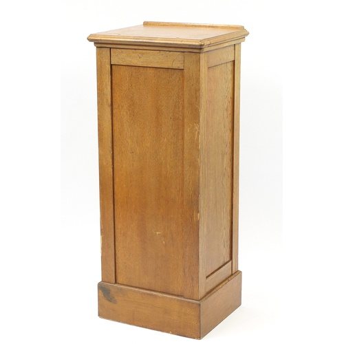 2037 - 1920's oak filing cabinet with tambour front with easel top, 116cm H x 49cm W x 42cm D