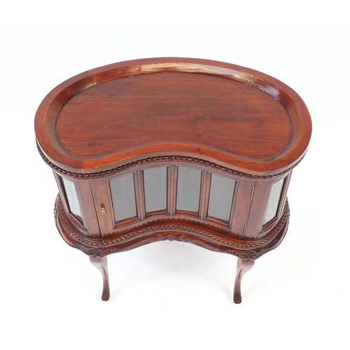 2041 - Mahogany kidney shaped cocktail cabinet with lift off tray top above bevelled glass panels, 77cm H x...
