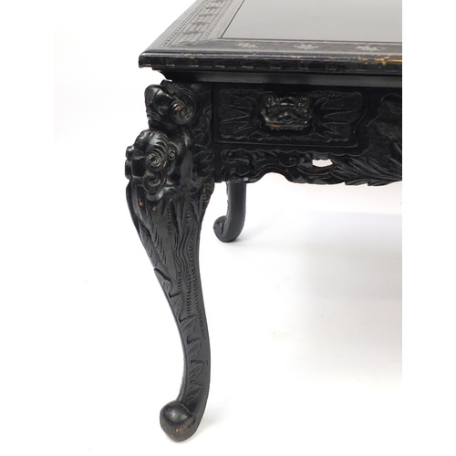 2018 - Ebonised carved oak centre table fitted with two draws, the top carved with Greek key and raised on ...