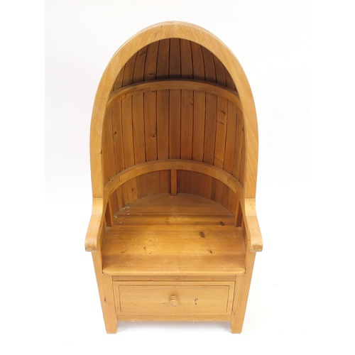 2003 - Pine porter chairs in the form of boat hull with draw to the base, 147cm high...