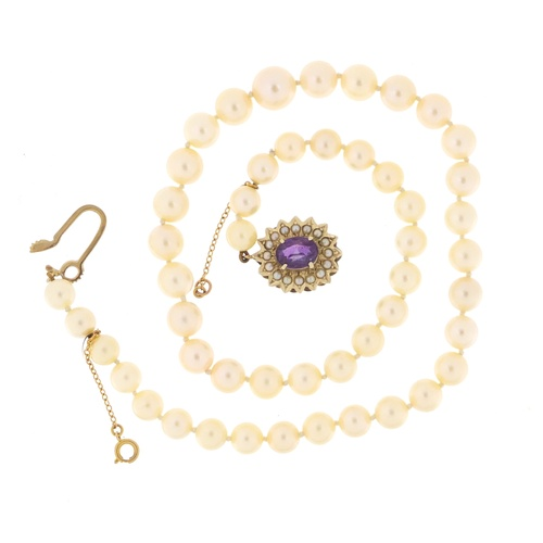 2519 - Single string pearl necklace with 9ct gold amethyst clasp, 36cm in length, 29.7g...