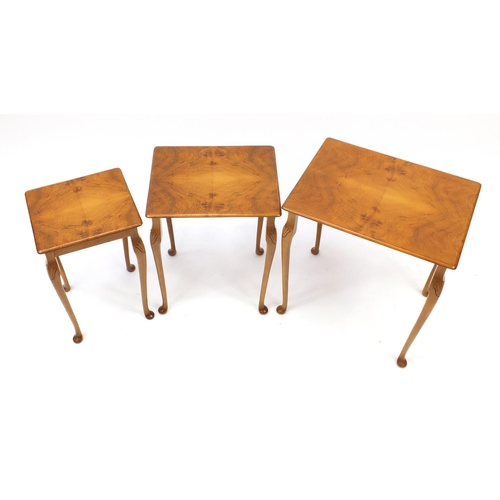 2059 - Nest of three walnut occasional tables...