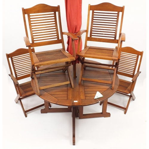 2008 - Firman teak folding garden table with four chairs and parasol...