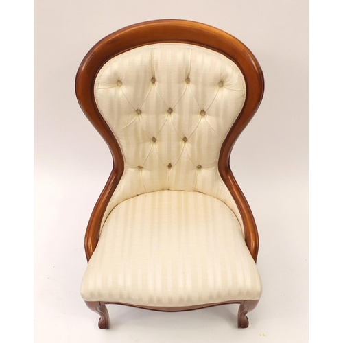 2052 - Mahogany framed bedroom chair with cream striped button upholstery, 91cm high...