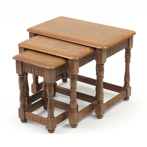 2039 - Nest of three elm occasional tables, the largest 46cm H x 60cm W x 37cm D...
