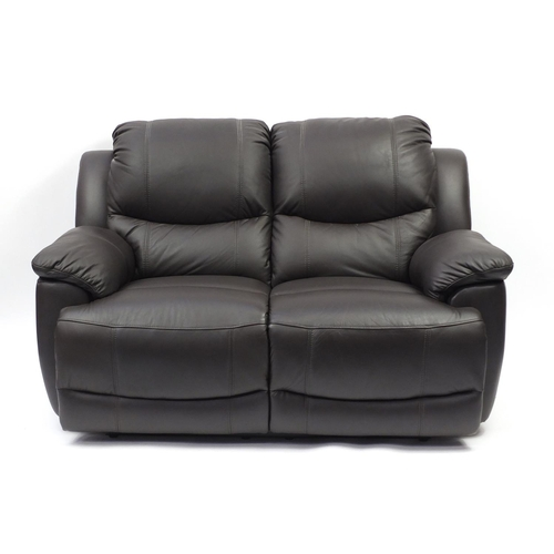 2012 - Brown leather manual reclining two seater settee, 155cm wide...