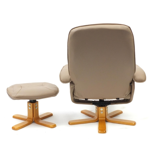 2001 - Light brown faux leather easy chair and foot stool...