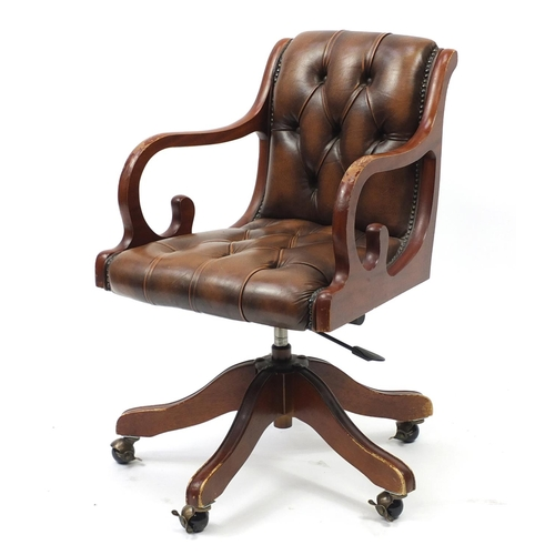 2045 - Mahogany framed captains chair with brown leather button back upholstery...