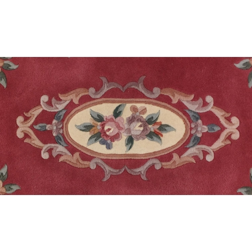 2028 - Chinese pink ground floral rug, 160cm x 100cm...