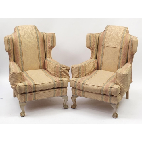 2013 - Pair of wingback armchairs with ball and claw feet and striped upholstery, 100cm high...