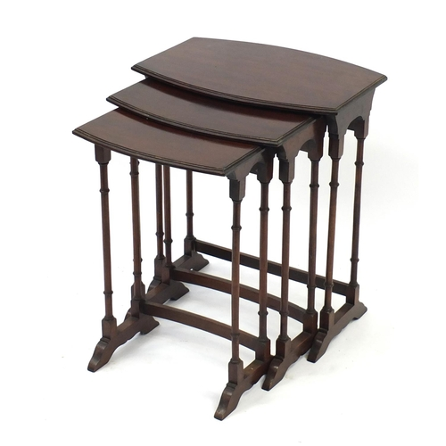 2047 - Nest of three mahogany bow front occasional tables with simulated bamboo legs, the largest 63cm H x ...