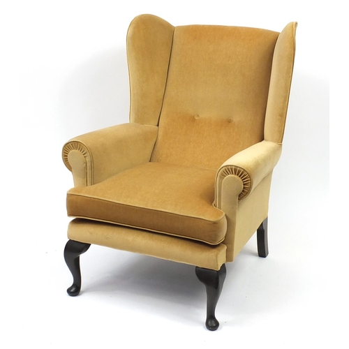2048 - Sherwood mahogany framed wingback armchair with gold upholstery, 101cm high...