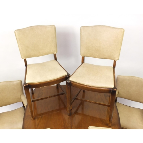 2005 - Art Deco walnut draw-leaf dining table and six chairs including two carvers with cream leather backs...