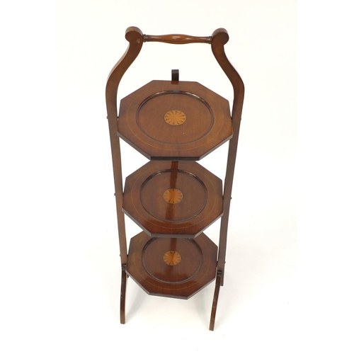 2026 - Edwardian inlaid mahogany three tier folding cake stand, 94cm high...