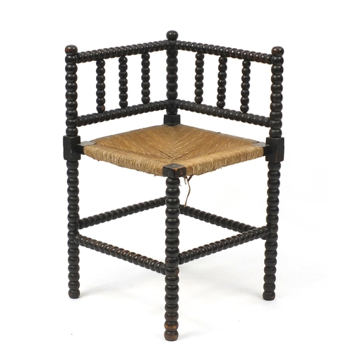 2057 - Antique bobbin turned corner chair with rush seat, 68cm high...