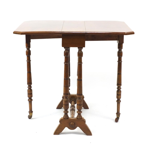 2009 - Edwardian walnut Sutherland table, 62cm high...