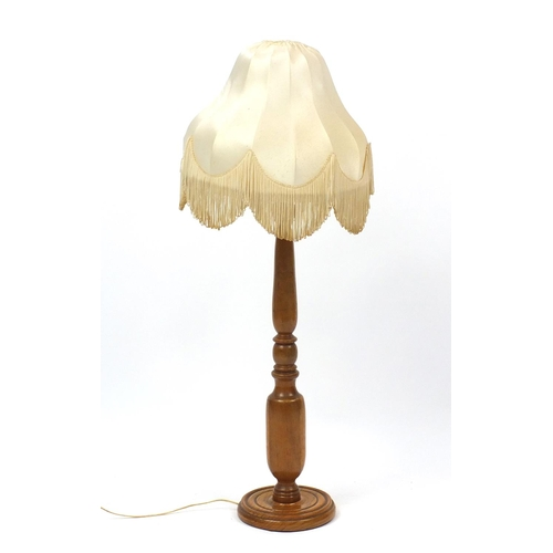 2025 - Turned oak floor standing lamp with shade, 93cm high...