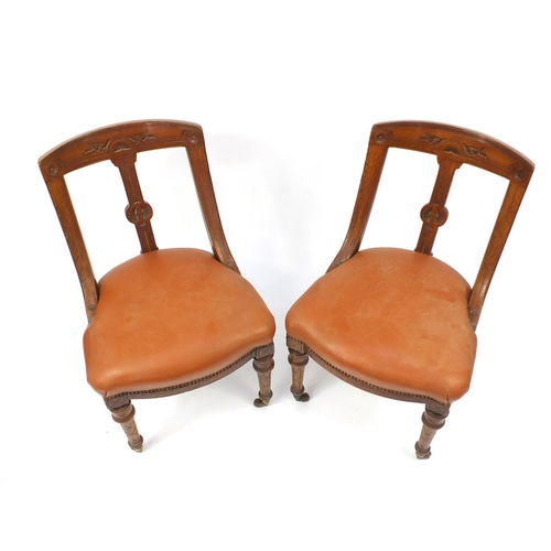 2017 - Pair of Victorian oak chairs with brown leather seats, 85cm high...