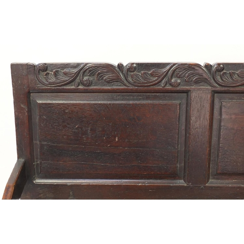 26 - Antique oak hall bench carved with foliage, 101cm H x 182cm W x 66cm D...