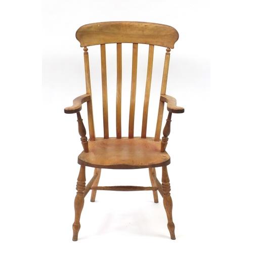 2054 - Beech and elm slat back open armchair, 110cm high...