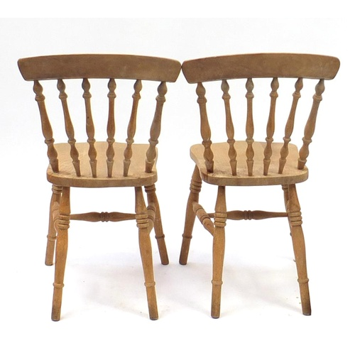 2043 - Pair of pine spindle back chairs, 87cm high...