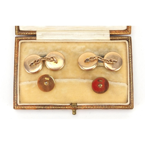 43 - 9ct gold and mother of pearl gentlemen's dress stud and cufflink set, housed in a Finnigans Ltd fitt...