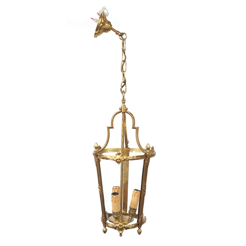 29 - French style brass and glass hanging lantern with acorn finials, 55cm high excluding the chain...