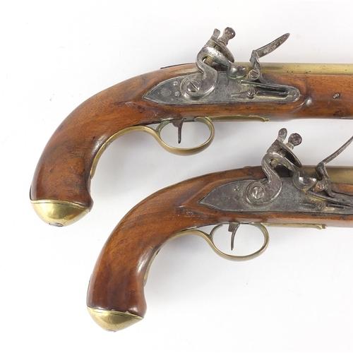 57 - Pair of George III walnut flintlock holster pistols by Thomas Ketland & Co, the brass barrels stampe...