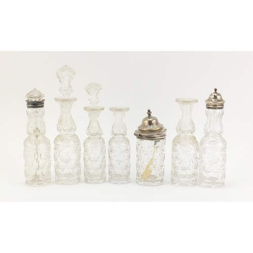 33 - Victorian silver seven bottle cruet stand by Thomas Smily, with seven glass bottles, some with silve...