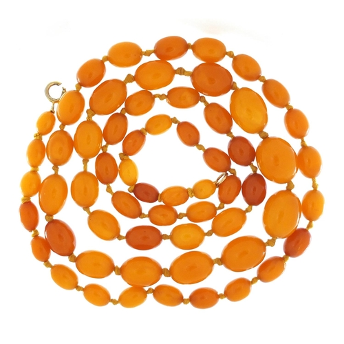 11 - Butterscotch amber coloured bead necklace, 100cm in length, 49.8g...