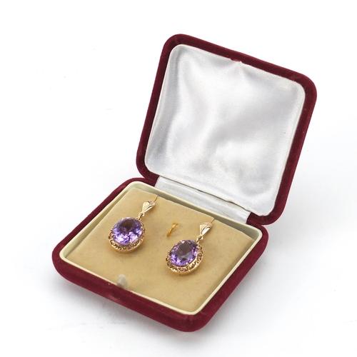 41 - Pair of unmarked gold amethyst earrings, 3.2cm in length, 8.4g...