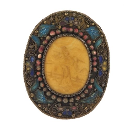 15 - Chinese ivory and enamel brooch, the ivory panel carved with a Geisha girl, 4cm in length, 10.4g...