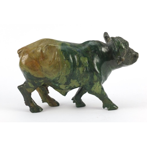 3038 - Chinese malachite carving of a water buffalo, 25cm in length...